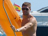 Captain of this ship: Steven Gerrard relaxes in Ibiza with his family on holiday