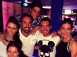 Posing up: Liverpool players enjoyed a night out on the town with their wives and girlfriends