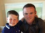 Happy family: Rooney and Kai both smile for picture as they enjoy their time in Turkey