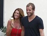 All smiles: Dutch footballer Van Der Vaart and his girlfriend Sabia Boulahrouz go on a romantic walk