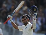 100 club: Rahane raised his helmet and bat to the crowd and his team-mates at Lord's