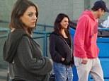 Bump undercover! Pregnant Mila Kunis and beau Ashton Kutcher enjoy a casual lunch break