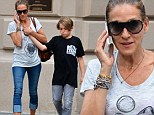 Hands-on mom: Sarah Jessica Parker holds tightly to son James, 12, as they cross a NYC street