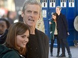 Peter Capaldi embraces assistant Jenna Coleman as they film new Doctor Who scenes
