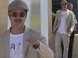 Cute shirt: Brad Pitt wore a shirt with a doodle of him and fiancee Angelina Jolie as he arrived on Thursday at the Marseille Provence Airport in France