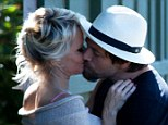 PICTURED: Pamela Anderson spotted kissing husband Rick Salomon... just one week after it was revealed she filed for divorce 'to scare him'