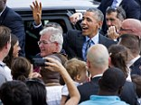 President Barack Obama greets people waiting for him after he arrived at John F. Kennedy International Airport in New York on Thursday. Republicans are blasting Obama for heading to New York for fundraisers in the wake of the Malaysian Airlines plane crash