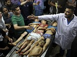 The bodies of four children, three of them from the same family, lie on a slab at the morgue at Al Shifa Hospital in Gaza City