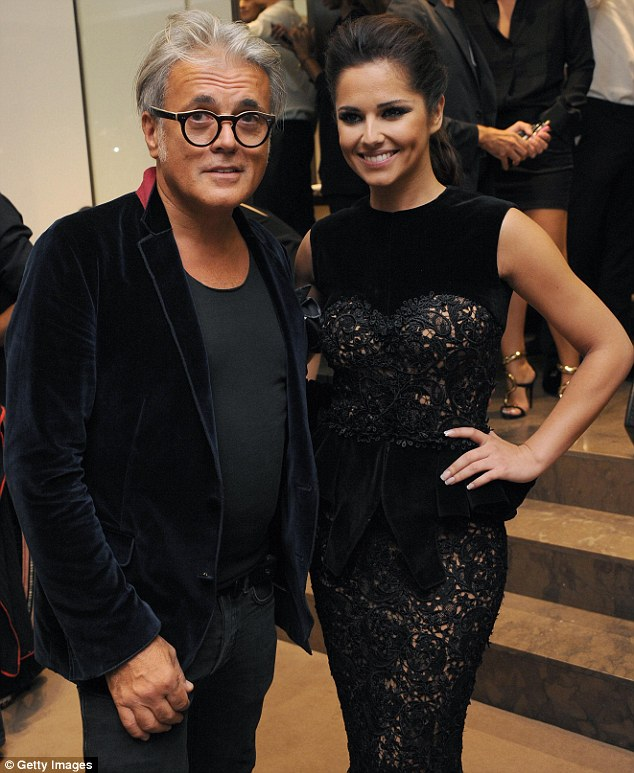 Best of friends: Cheryl posed up with designer Giuseppe Zanotti inside the store