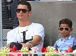 Father and son: Cristiano Ronaldo with Cristianinho in Madrid where the boy lives with his father and grandmother