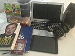 Ready to go: Chelsea captain John Terry shows off the contents of his bag before flying to Austria