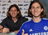 Blue: Chelsea's new signing Filipe Luis signs for Chelsea FC