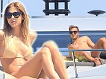 Sunny: Mario Gotze relaxes on boat in Ibiza with lingerie model girlfriend