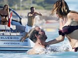 Good time: Rafael van der Vaart and Sabia Boulahrouz enjoy the sun in St Tropez