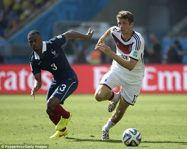 World Cup standard: Evra competes with Thomas Muller at the World Cup