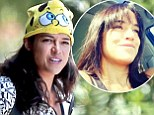 Washing that man right out of your hair? Solo Michelle Rodriguez steps out without Zac Efron wearing a Sponge Bob beanie before getting a new look