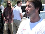 Brothers at work: Andrew Wilson directed his younger brother Luke on Monday while filming in Santa Monica, California