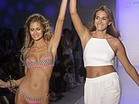 Making history: 19-year-old designer Francesca Aiello, of Frankie's Bikinis (right) hits the runway with a model at the end of her Mercedes-Benz Fashion Week Swim show in Miami Beach on Friday