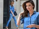 Spicing up her style: Miranda Kerr spruced up her double denim look with a pair of leopard heels as she stepped out in New York City on Monday