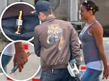 Zac Efron leaves Michelle Rodriguez's house toting an overnight bag and with a vaporizer in his back pocket while she also carries one around on movie set