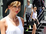 Taylor Swift wears a fetching black fedora and black shorts for gym workout with BFF model pal Karlie Kloss