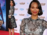 Out of this world! Zoe Saldana displays bra under space age metallic dress (cleverly disguising her 'baby' belly) at Guardians Of The Galaxy premiere