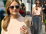 Still waiting! Olivia Palermo remains wedding ring-free as she heads out to lunch in New York