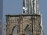 Surrender? A vandal replaced the American flags atop the Brooklyn Bridge with white banners on Tuesday - the international symbol for surrender