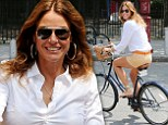 So that's how she gets those legs! Kelly Bensimon, 46, shows off her impressively toned pins on a bike ride in New York