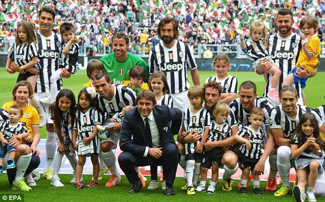Family ties: Antonio Conte, Juventus players and families pose for photos after the game