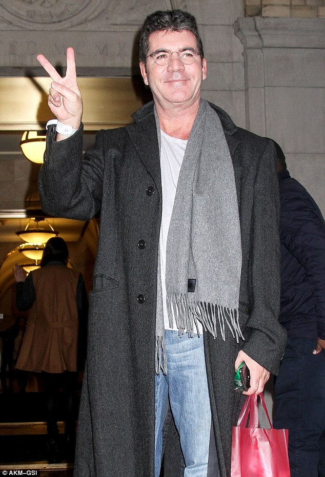 Feeling peaceful? Simon looked happy, radiant and full of energy as he smiled for the shutterbugs