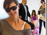 Home sweet home! Katie Holmes and her daughter Suri smiled as they arrived at JFK airport in New York on Wednesday