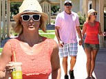 They've got that lovin' feeling: Britney Spears holds hands with David Lucado during lunch date