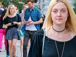 Perfect match! Make-up free Dakota Fanning and boyfriend Jamie Strachan coordinate in his and hers blue tartan for a Big Apple date