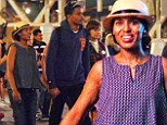 Kerry Washington and husband Nnamdi Asomugha indulge in rare PDA as they stroll hand-in-hand through Disneyland during fun family outing with daughter Isabelle