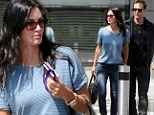 Courteney Cox nails off-duty chic in striped top and skinny jeans as she jets out of London with fiance Johnny McDaid and daugther Coco