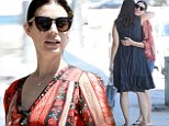 Girls' day out! Jessica Pare shares tender hug with a friend after lunch while showing off her long legs in tiny shorts