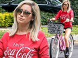 Getting in shape for the wedding Ashley? Tisdale goes for a bike ride in pair of short shorts which show off her toned legs
