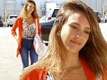 Summer chic: Jessica Alba stood out in a bright orange cardigan and colourful blouse as she arrived at The Honest Company in Santa Monica on Wednesday