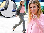 Ouch! AnnaLynne McCord slips on comfy slippers after running around on set in VERY high heels