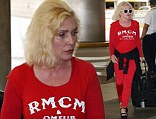 Heart of class! Ageless Debbie Harry, 69, looks ravishing in casual red two-piece as she arrives at Miami International Airport