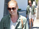 Keeping it casual! Cat Deeley puts on a leggy display in relaxed white dress and khaki jacket as she leaves salon
