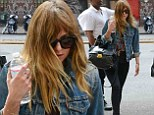 Leggy lady: Dakota Johnson highlighted her long legs in skintight black trousers teamed with a denim jacket as she grabbed lunch with a friend in New York City on Tuesday