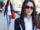Leggy lady: Emmy Rossum highlighted her shapely legs in skintight denim capris as she strode along in pale blue alligator skin heels in Beverly Hills on Tuesday