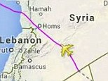 Rerouted: The map shows flight MH4 flying over Syrian airspace on Sunday
