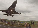 That was close! The fighter jet soars above the plane spotters as it comes in to land at a nearby runway