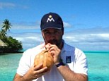 Coconut for one: David cools off with a tropical drink as he enjoys the delights of French Polynesia