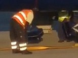 Bagged: Baggage handlers for a Ryanair flight were captured on amateur video at Bergamo Airport