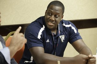 FIU center Donald Senat listens to a question during the NCAA college Conference USA football media day in Irving, Texas Wednesday, July 23, 2014.