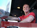 In charge: Rooney has a go in the fire engine during United's pre-season visit to Los Angeles